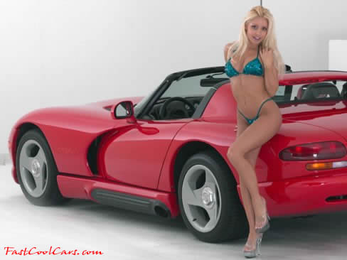 a beautiful Blonde model with a 1994 Dodge Viper