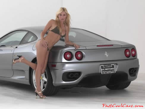 Sexy blonde model with a silver 2000 Ferrari Modena