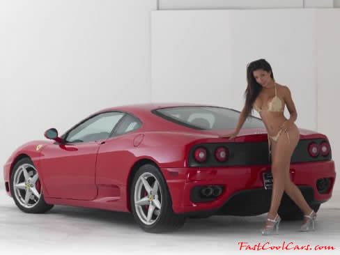 Beautiful brunette model and a 2000 Red Ferrari Modena.