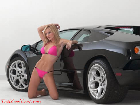 A sexy blonde model with a bad in black 2001 Lamborghini Diablo.