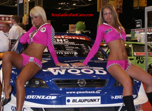Pretty models and a fast and the furious type vehicle.