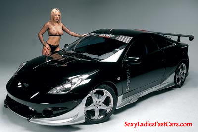Sexy model with fast and the furious low rider car, all pimped out.