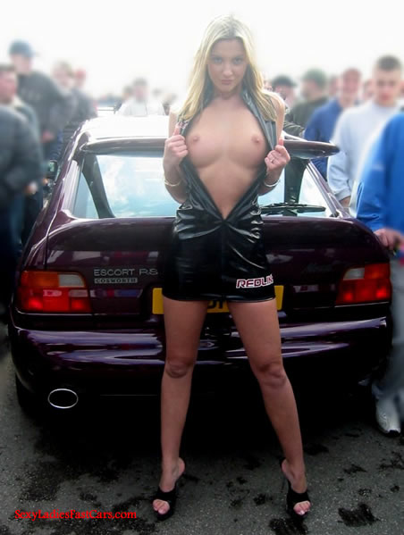 Sexy Lady with her tuner Ford at car show.