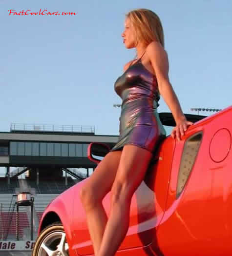 Beautiful lady standing with her sports car