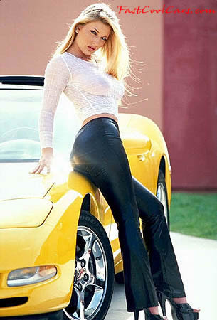 Pretty lady with Chevrolet Corvette, nice yellow color