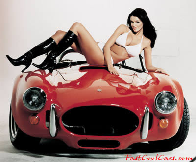 pretty lady with a fast cool Shelby Cobra car