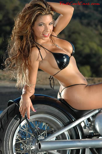 Sexy brunette with motorcycle