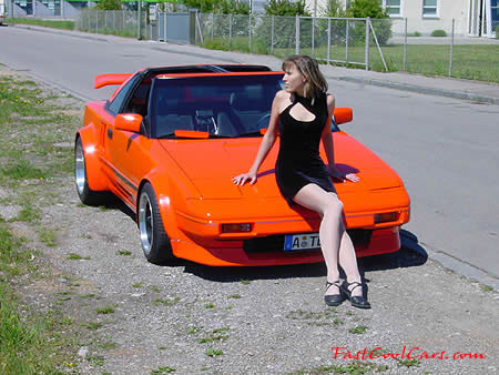 Pretty lady with Fast and the Furious looking fast cool car