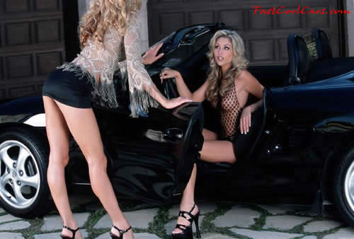 Black Porsche convertible, two blonde ladies