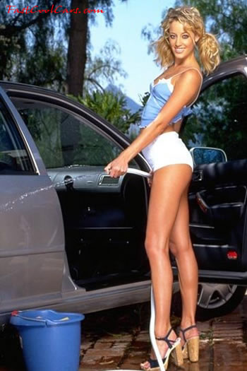 Blonde southern belle washing her car