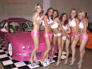 Sexy models with fast and the furious low rider car, all pimped out.