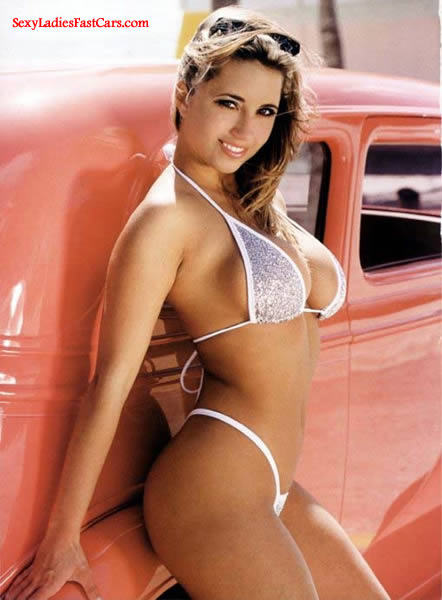 Sexy lady with classic street rod.