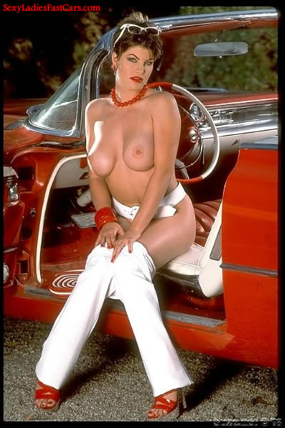 Pretty woman and her classic car