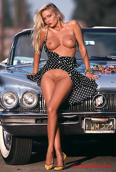 Sexy Blonde lady and her classic convertible.