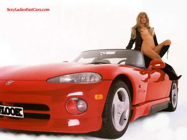 Sexy Blonde lady and her Viper convertible.