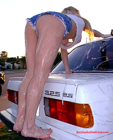 Sexy lady washing her BMW, boobs showing under shirt.