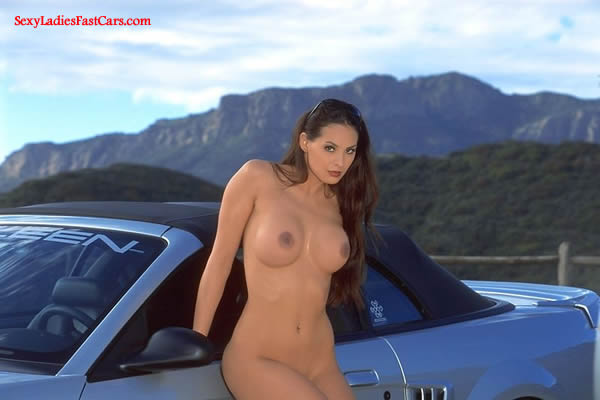 Sexy Brunette model with lovely body next to a sharp Ford Saleen Convertible. Beautiful Hooters!