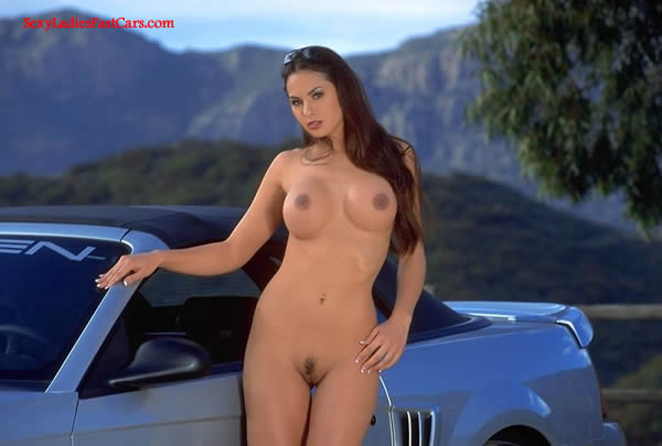 Sexy Brunette model with lovely body next to a sharp Ford Saleen Convertible. perfect hooters...