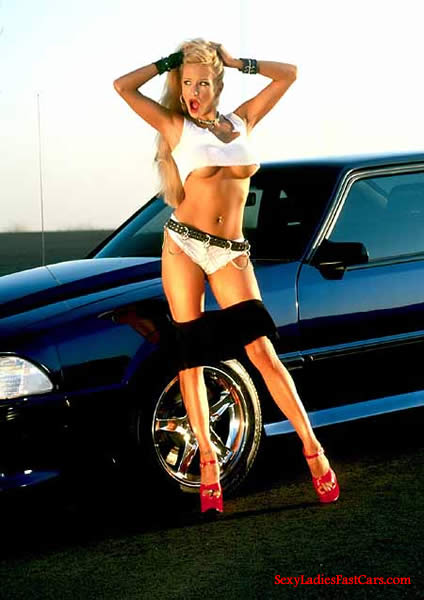 Sexy bonde model with Ford Mustang.