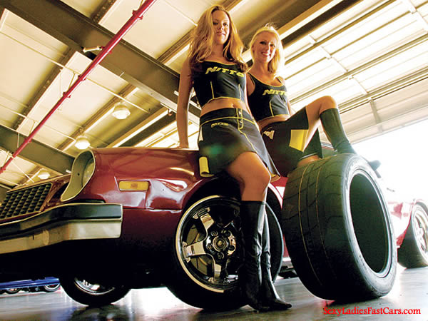 Sexy bonde models with a Camaro