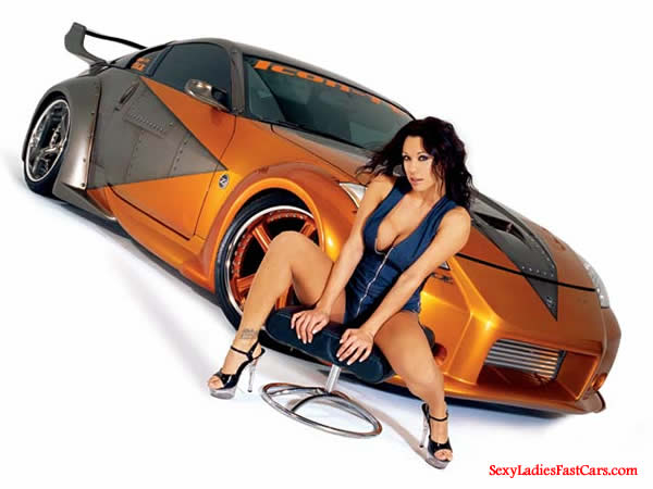 Sexy brunette woman with her killer fast and the furious type Nissan 350Z it looks like.